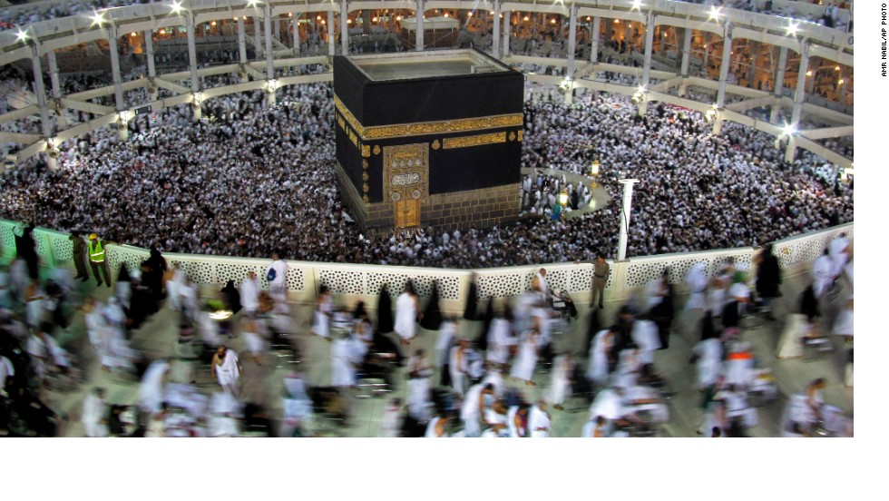 "OCTOBER 15 - MECCA, SAUDI ARABIA: Pilgrims circle the Kaaba as they pray inside the Grand Mosque during the Hajj. Every Muslim is expected to take this <a href=""http://religion.blogs.cnn.com/2013/10/14/ireporters-5-life-lessons-from-the-hajj/?hpt=hp_mid"">journey to the holy city of Mecca</a> during their lifetime. This year, the Saudi government asked people with weakened immunity to <a href=""http://www.cnn.com/2013/07/13/world/meast/saudi-arabia-pilgrims-masks/index.html"">avoid the journey</a>, due to an <a href=""http://www.cnn.com/2013/08/29/health/mers-cornoavirus-new-cases/"">outbreak of MERS virus </a>in the birthplace of Islam."