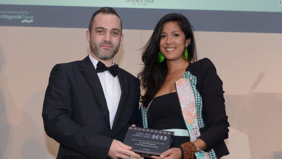 CNN correspondent Ayesha Durgahee is presented with an award for Business Travel News Journalist of the Year by Dan Corfield, Senior Manager at Brand Public Relations, at the 2013 Business Travel Journalism Awards.