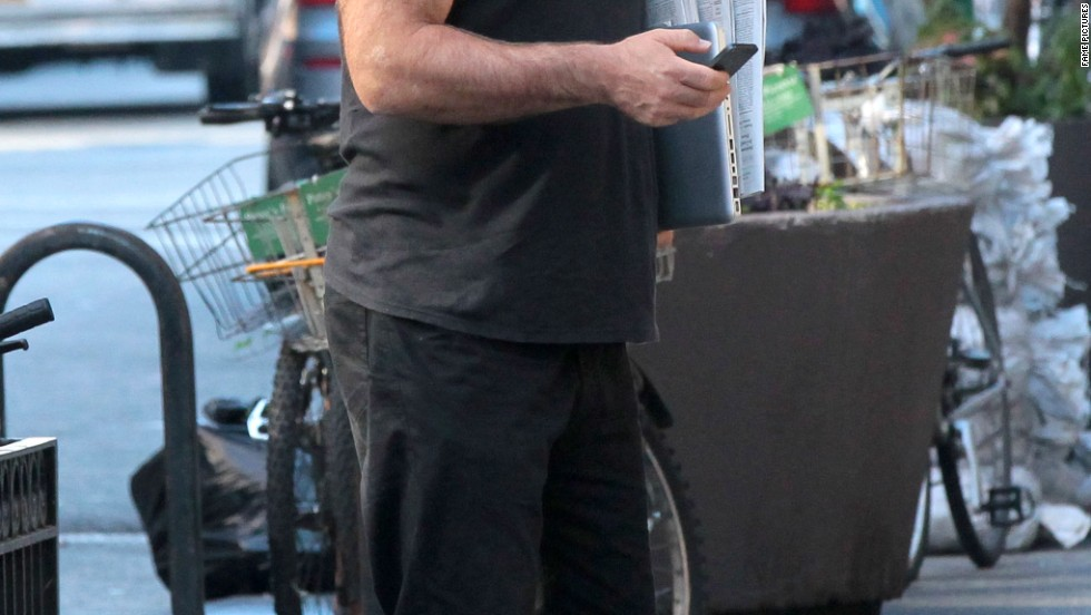 Alec Baldwin doesn't walk and text while strolling the streets of New York.