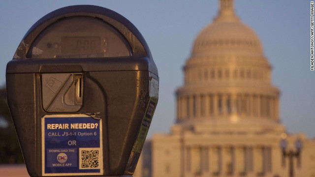 The US Congress building is seen behind a parking meter in Washington, DC, October 14, 2013.  The crisis over a US government shutdown and debt ceiling standoff continues into the third week of the shutdown. With just three days before the US Treasury exhausts its borrowing authority, and the government entering its third week of a crippling shutdown, lawmakers have scrambled to work out a deal that would resolve both crises.  AFP PHOTO/ MLADEN ANTONOV MLADEN ANTONOV/AFP/Getty Images