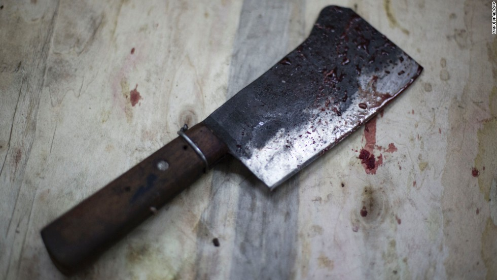 A blood-stained cleaver sits on a block after an animal was slaughtered in downtown Cairo on October 15.
