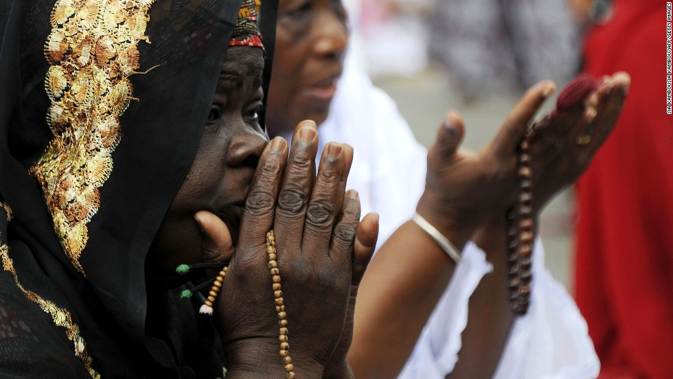Muslims pray during Eid al-Adha, also known in the Ivory Coast as the Tabaski, on October 15 in Adjame, a popular district of Abidjan.