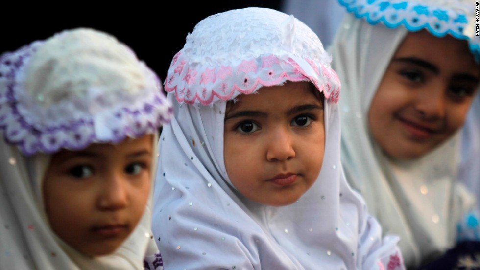 Palestinian girls attend prayer services at Al-Yarmouk stadium in Gaza City on October 15.