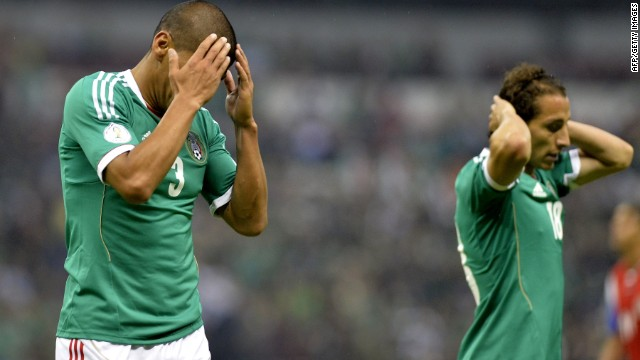 Carlos Salcido (L) and Andres Guardado of Mexico reacts after missing a goal during their FIFA World Cup Brazil 2014 qualifier football match against Costa Rica at the Azteca stadium in Mexico City on June 11, 2013. The game ended 0-0. AFP PHOTO/OMAR TORRES (Photo credit should read OMAR TORRES/AFP/Getty Images)