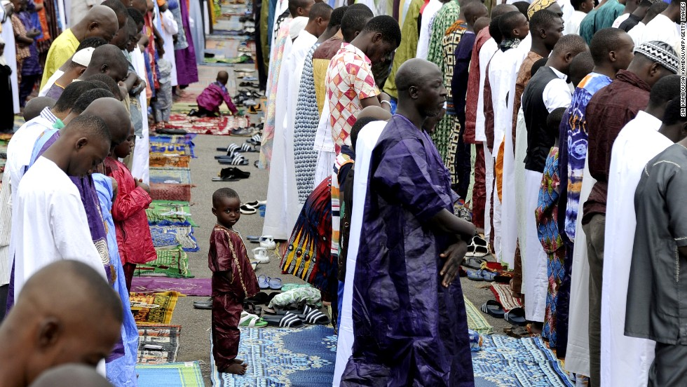 A young Muslim boy attends prayer services on October 15 in Adjame in the Ivory Coast in West Africa.