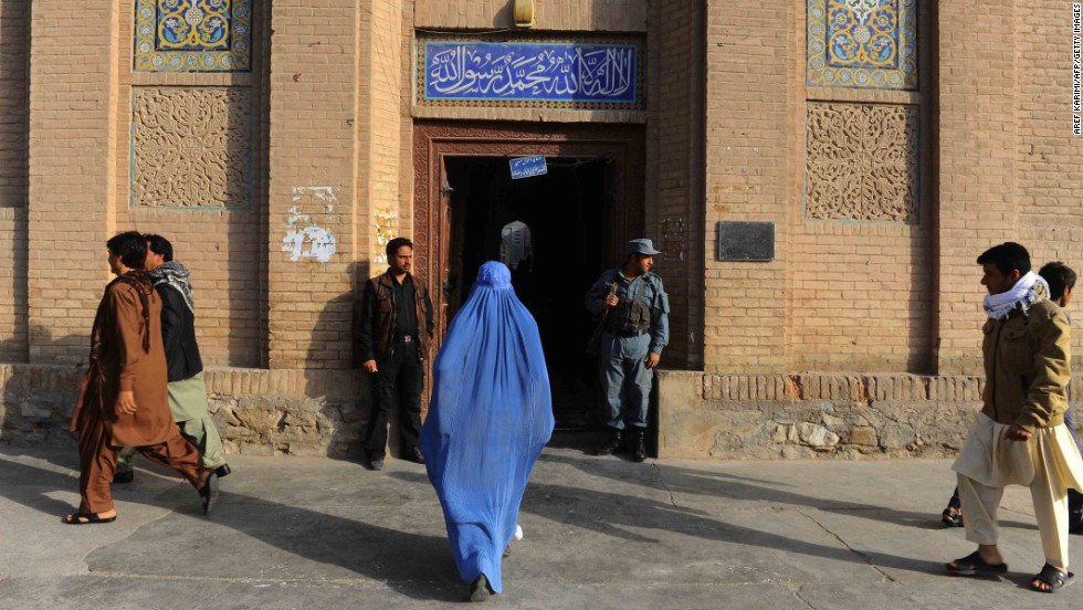 An woman walks to the Jame mosque before prayers in Herat, in western Afghanistan, on October 15.
