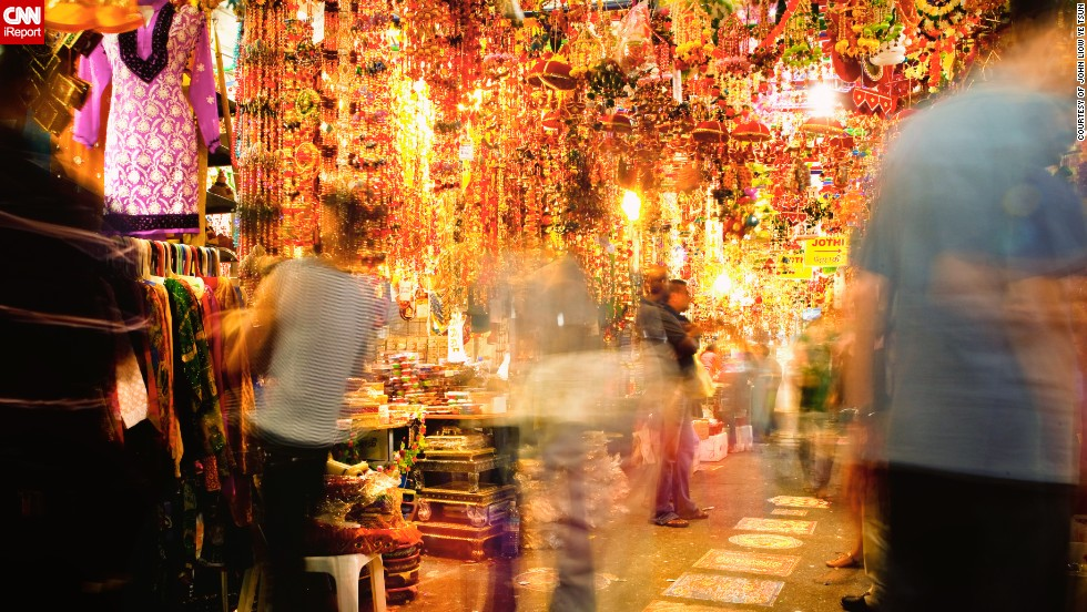 """This beautiful photo captures the hustle and bustle of the bazaars along <a href=""""http://ireport.cnn.com/docs/DOC-1044338"""" target=""""_blank"""">Serangoon Road in Singapore</a>. """"The area is affectionately known to locals as """"Little India"""" and it consists of stalls selling clothes, lamps, flowers, home accessories, food delicacies, anything that a believer could need for the Diwali celebrations and a fresh start to the new year,"""" said John Liow Ye Tsun. """"I'm Christian by faith so while I don't celebrate Diwali personally, a large number of my friends are Hindu and it's through their invitations that I understand this tradition, and get to experience a slice of the celebration,"""" said the 40-year-old."""