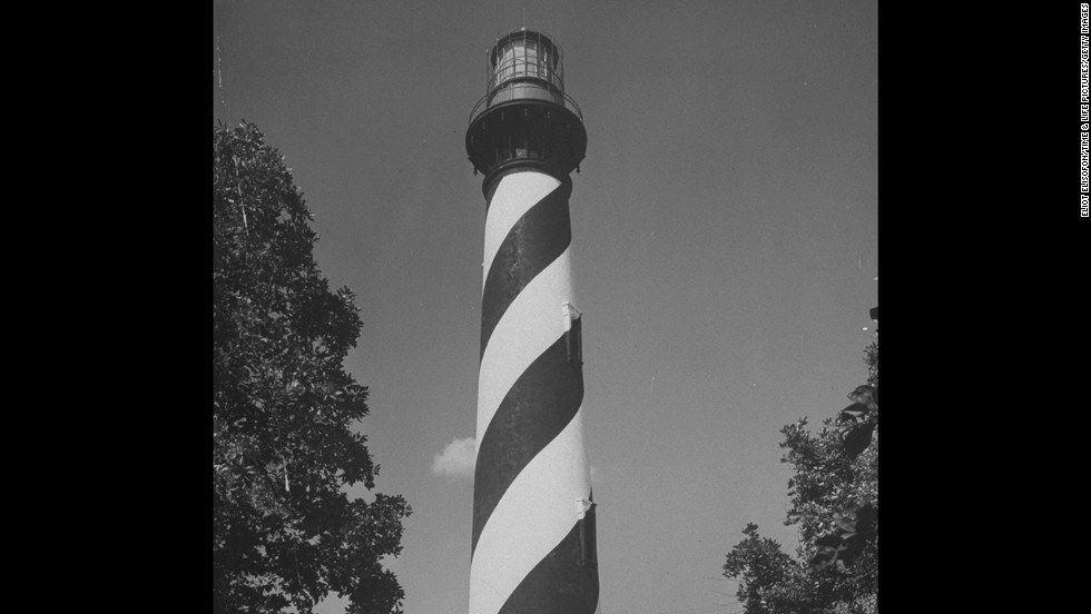 "St. Augustine's lighthouse (shown here circa 1946) is the town's oldest structure, dating back to 1874.  The ""Dark of the Moon"" tour is billed as ""the only ghost tour that gets you in the tower."""