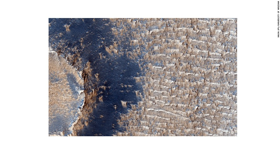 "The ceaseless winds of Mars create sand dunes all across its surface. But beneath these dunes in Syria Planum are bright deposits with steep faces and sharp, weathered ridges. These lower deposits are evidence that in Mars' past the winds were <a href=""http://hirise.lpl.arizona.edu/ESP_032735_1680"" target=""_blank"">much more ferocious</a>."