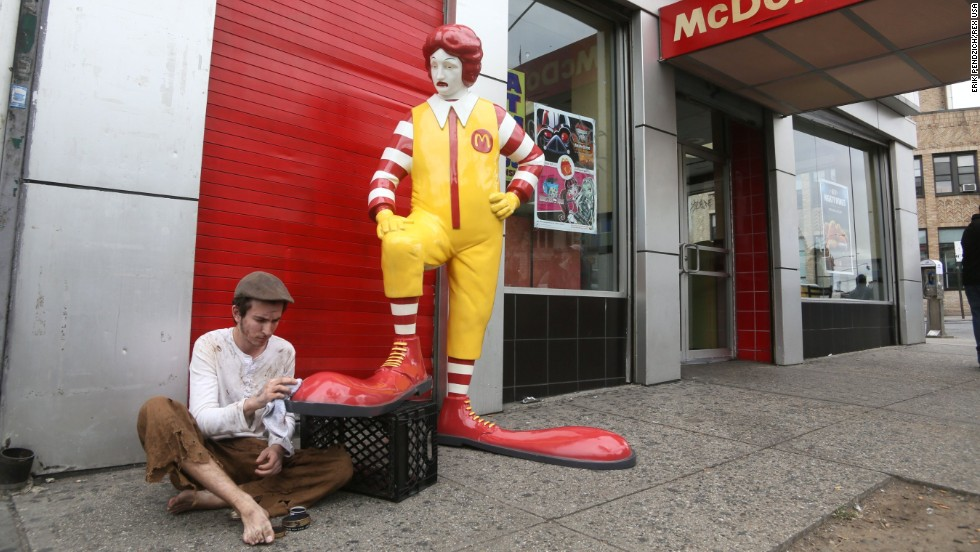 The artist created a fibreglass replica of Ronald McDonald having his shoes shined by a boy in South Bronx.