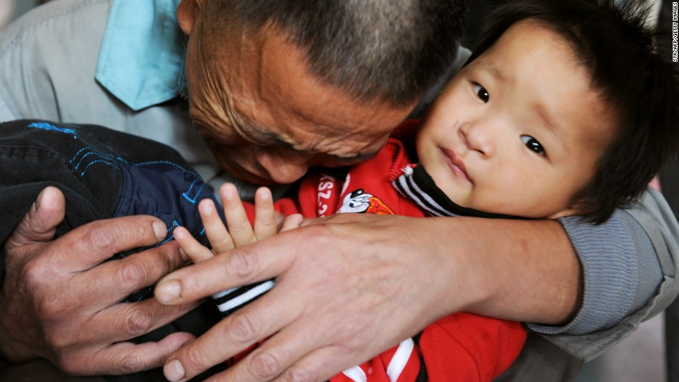 Wang Bangyin breaks down as he hugs his rescued son at a welfare center for children in China's Guizhou province in 2009. The boy was among 60 children rescued by police from human traffickers. Nearly 3 million people in China are victims of forms of modern slavery, including forced marriage, sexual exploitation and forms of forced labor such as domestic servitude, forced begging and forced marriage.
