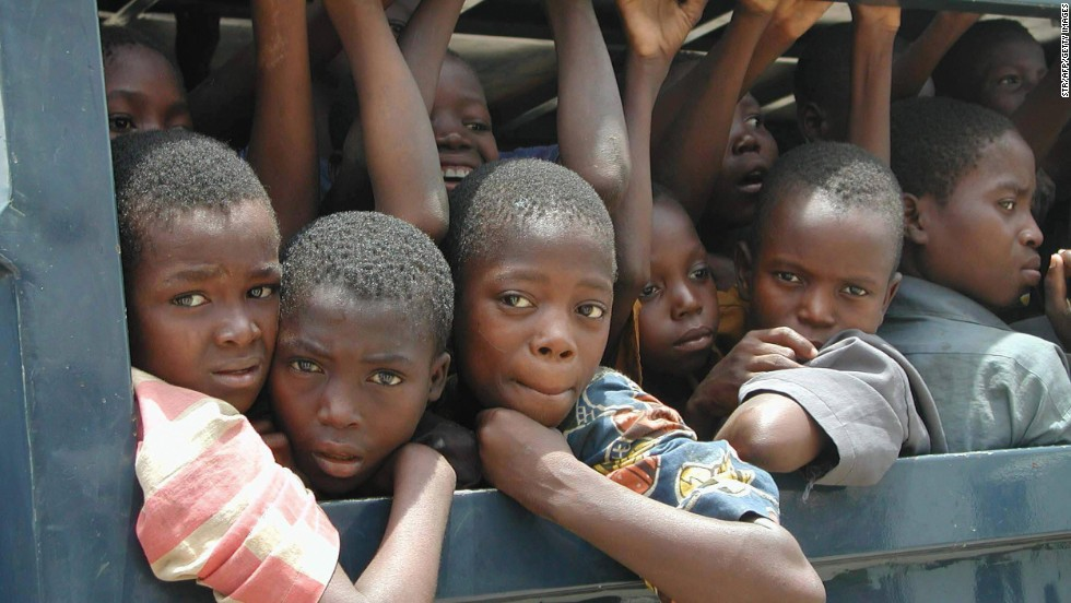 Dozens of slave children ride in the back of a police vehicle after they were apprehended at Seme Border, Nigeria. Much slavery in Nigeria and neighboring Benin involves the trafficking of women and children for sexual exploitation, domestic work or forced labor.