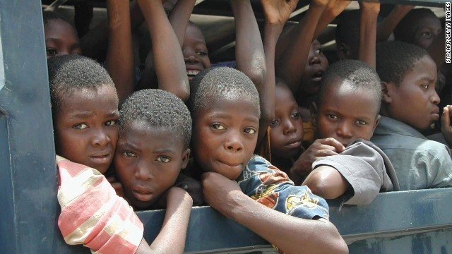 This photo, taken in 2003, shows slave children ridding in the back of a police vehicle. Millions of such children in developing countries have no documents proving they exist.