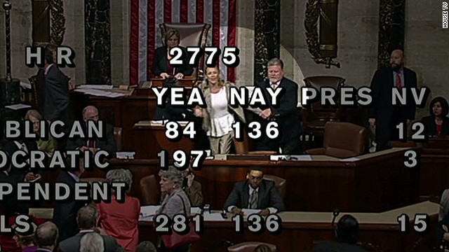 Woman escorted from House floor