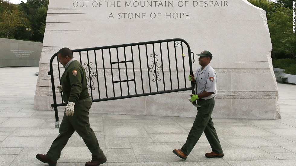 U.S. Park Service workers remove a barricade from the Martin Luther King Jr. Memorial in Washington on October 17.