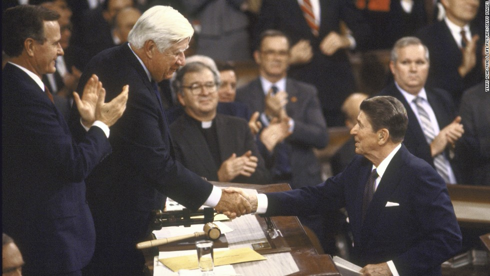 President Ronald Reagan, right, shakes hands with House Speaker Tip O'Neill during the State of the Union address in 1986. The two men had battled bitterly over Social Security reform until amendments were made to the Social Security Act in 1983.