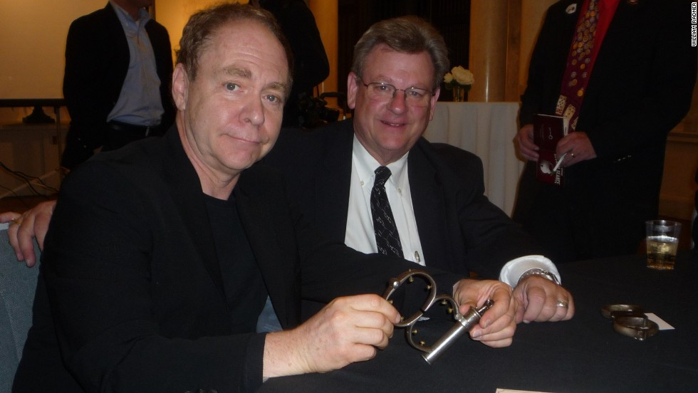 The magician know as Teller holds the Houdini cuffs at the conclusion of a séance in 2011 in Holyoke, Massachusetts. The cuffs remain locked.