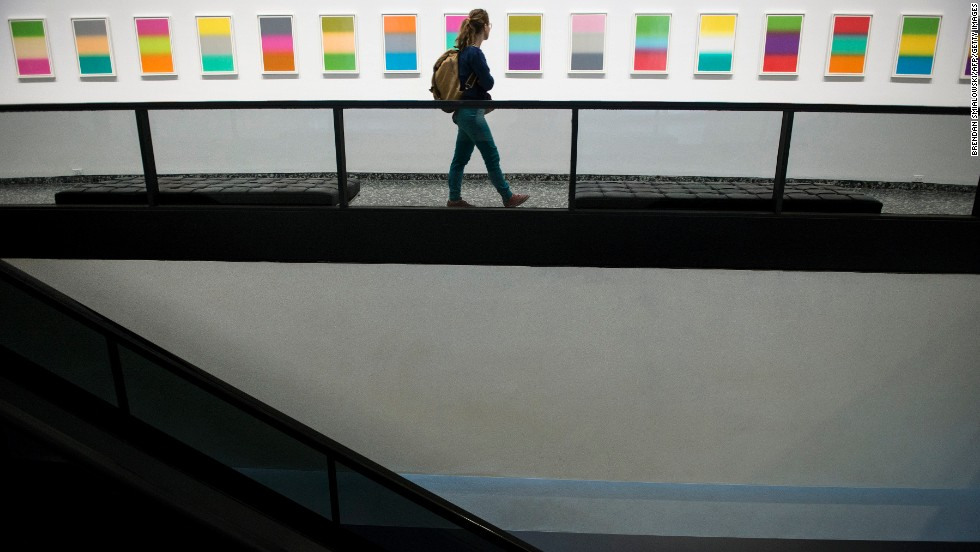 A visitor checks out art in the Hirshhorn Museum and Sculpture Garden in Washington on Thursday, October 17.