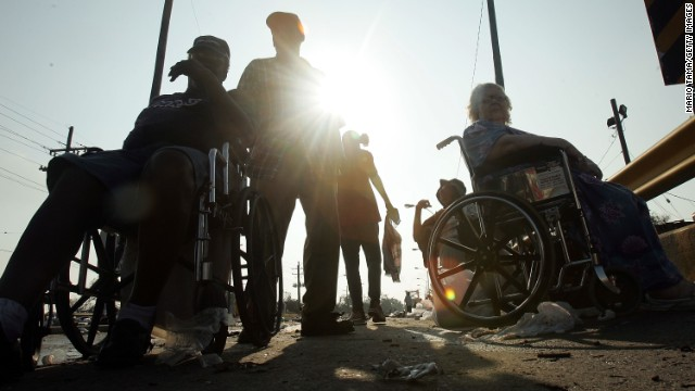 Disabled residents wait for help after being rescued from their nursing home during Hurricane Katrina in 2005 in New Orleans.