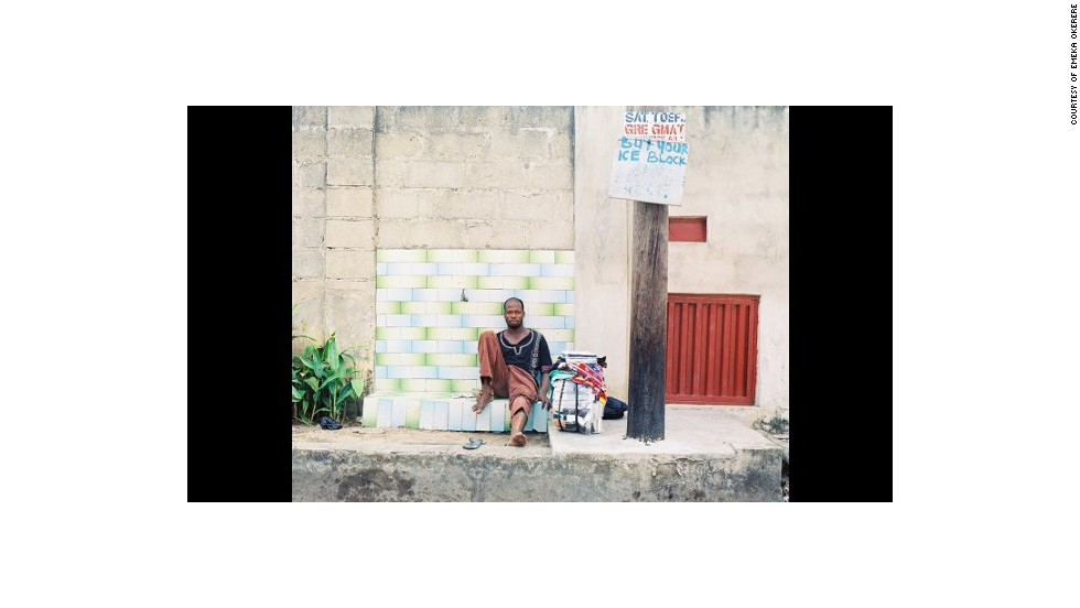 """Portrait of a Trader,"" by Nigerian Emeka Okereke, shows a street trader taking a short break from his work among the heavy traffic of Lagos."