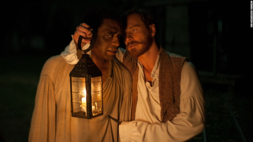 "<strong>No. 10:</strong> It's difficult to think of ""12 Years a Slave"" as a ""favorite"" because of the painful history it unflinchingly presents, but we understand why CNN readers voted for it. If nothing else, this masterful film will be a favorite of cinephiles for years to come thanks to its tireless director, top-notch script and incredible performances from stars such as Chiwetel Ejiofor, left, and Michael Fassbender."