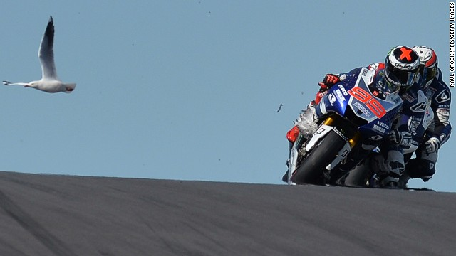 A seagull gets trapped in the forks of Jorge Lorenzo's Yamaha, while another flies in the background at the top of Lukey Heights.