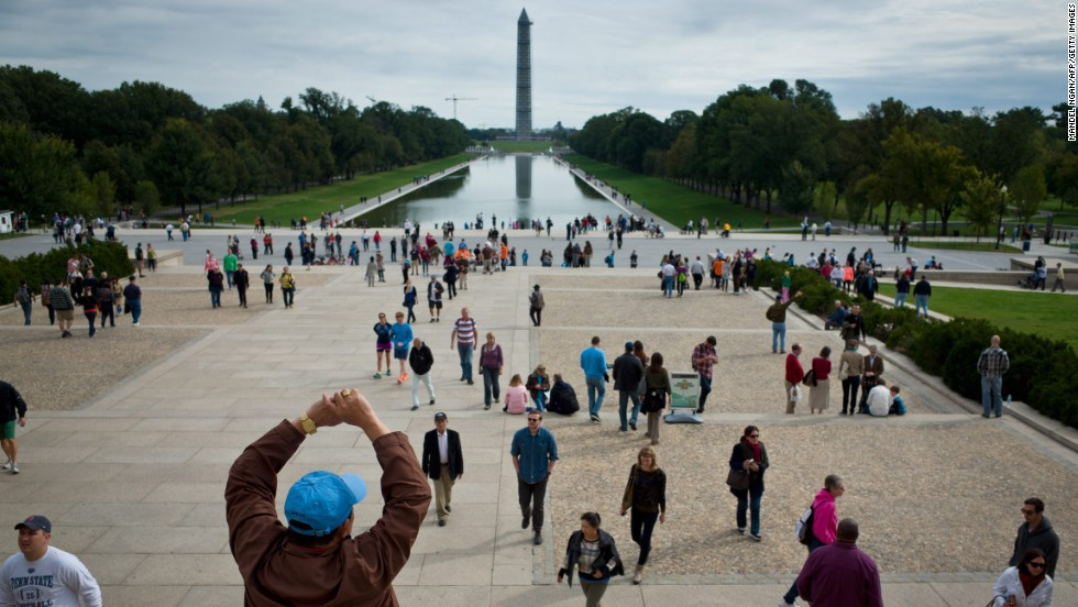 Tourists flock to memorials in Washington on Saturday, October 19, the first weekend after the end of the partial government shutdown. The Washington Monument and other landmarks across the country have reopened to the public after the 16-day shutdown. The government impasse ended when President Barack Obama signed a spending and debt ceiling agreement that Congress passed, averting a possible default.