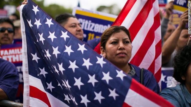 WASHINGTON, DC - OCTOBER 8: Lorena Ramirez, of Arlington, Virginia, holds up an American flag during a rally in support of immigration reform, in Washington, on October 8, 2013 in Washington, DC. Last week, House Democrats introduced their own immigration reform bill. (Photo by Drew Angerer/Getty Images)