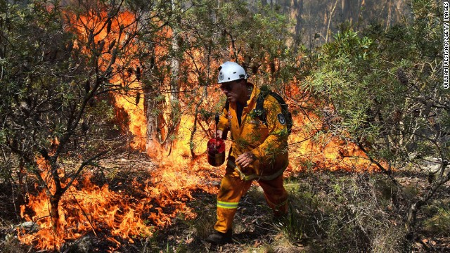 A firefighter lights a back burn near Mount Victoria in the Blue Mountains of Australia on Monday, October 21.