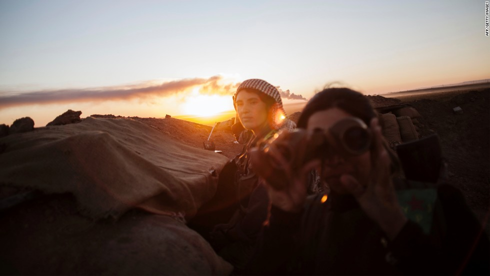 "OCTOBER 21 - HASAKEH, TURKISH-IRAQI BORDER: Female Kurdish fighters guard a fortified wall, checking for activities by the Al Qaeda-affiliated opposition Jabat al-Nusra, which has been designated as a terrorist group by the U.S. <a href=""http://www.cnn.com/2013/08/29/opinion/bergen-al-qaeda-power-syria/"">Concerns about the Islamist rebel group Jabhat al-Nusra are at an all-time high</a> with as many as 10,000 fighters and supporters inside Syria."