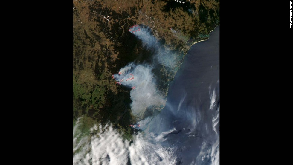 Smoke from the bush fires is seen burning near Sydney in this October 21 photo released by NASA. New South Wales is Australia's most populous state. One in three Australians live there.