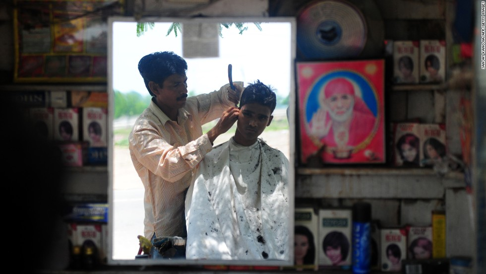 In India, it's not just the hair on your head that gets a snip. Barbers will take their scissors to wayward eyebrows, tufts of ear hair and nostrils. Then it's time to actually get started.