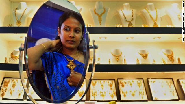 Indian women glory in dripping in jewelry.