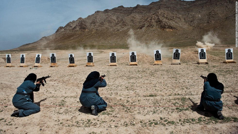Women—mostly widows—train for police force jobs at a firing range near Kabul, in this image by Lynsey Addario. The female officers can take on tasks that men cannot because of Islamic custom: frisking other women, searching homes where female family members are present.