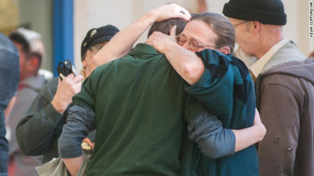 A  Sparks Middle School student cries with family members after being released from Agnes Risley Elementary School, where some students were evacuated to after a shooting at Sparks Middle School in Sparks, Nev. on Monday, Oct. 21, 2013 in Sparks, Nev.  A student at the Sparks Middle School opened fire on campus, killing a staff member who was trying to protect other children, police said Monday.  (AP Photo/Kevin Clifford)