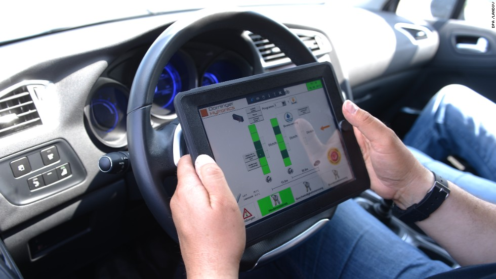 Driving instructor Horst Heider uses an iPad during a safety-training class for seniors in Boksee, Germany, on June 20, 2013.