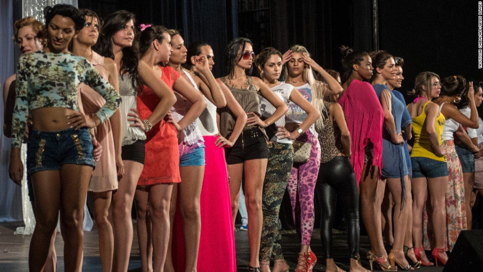 Contestants take part in a rehearsal Monday before the start of the pageant in Rio de Janeiro.