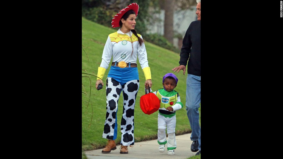 "If there were a costume contest for cutest mother-kid pair, Sandra Bullock and her son Louis would consistently be in it to win it. In 2012, mom Bullock dressed up as Jessie the Yodeling Cowgirl from the ""Toy Story"" films while her son went as Buzz Lightyear."