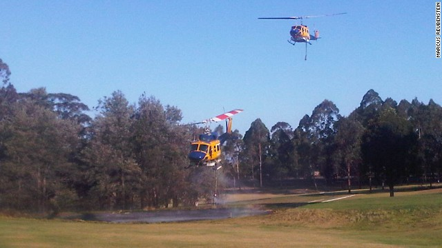 Helicopter water bombers fighting australian bushfires to resupply water in Blue Mountains, New South Wales.