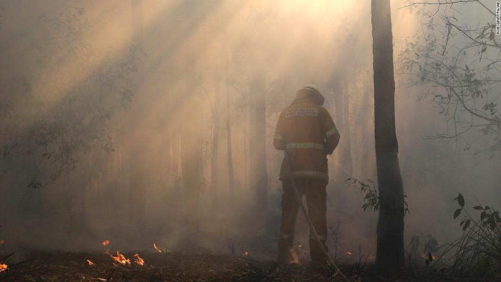 A firefighter mops up on October 23, after a firestorm swept through Bilpin.