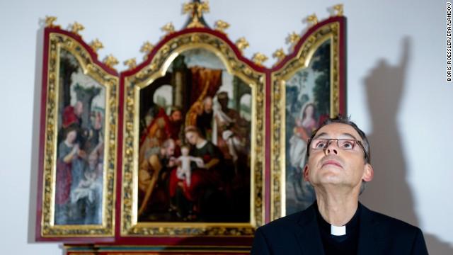 A shadow is cast behind Tebartz-Van Elst as he speaks in the chapel of the Old Vicariate in Limburg, Germany in December 2012.