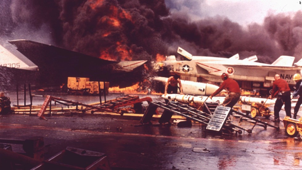 Planes burn aboard the USS Forrestal after a Zuni missile accidentally fired from another aircraft in July 1967. The incident involved then-Lt. Cmdr. John McCain, who ran for his life through the flames, according to Navy accounts. The accident left 134 people dead.
