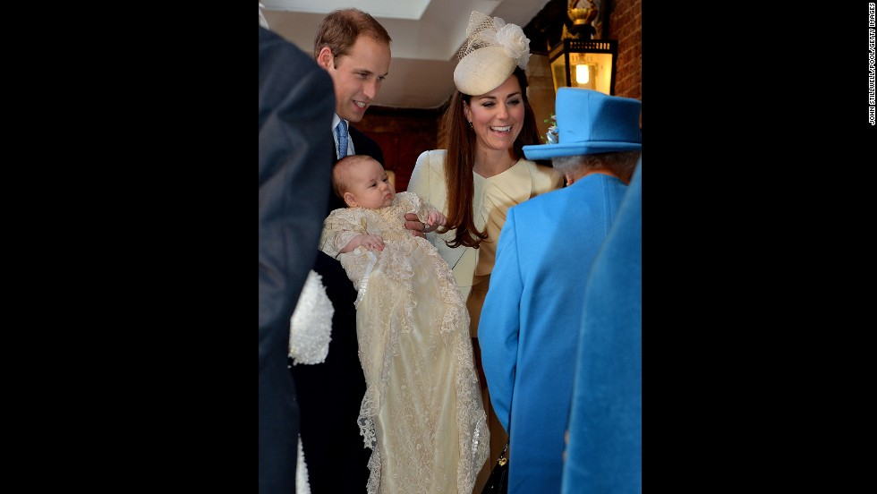 Prince William, Duke of Cambridge and Catherine, Duchess of Cambridge, talk to Queen Elizabeth II as they arrive with Prince George for the christening.