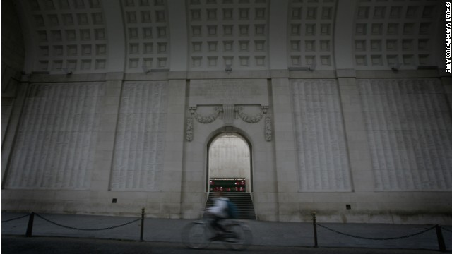 A cyclist passes the Menin Gate, a memorial to the troops that lost their life in and around Ypres in World War I.