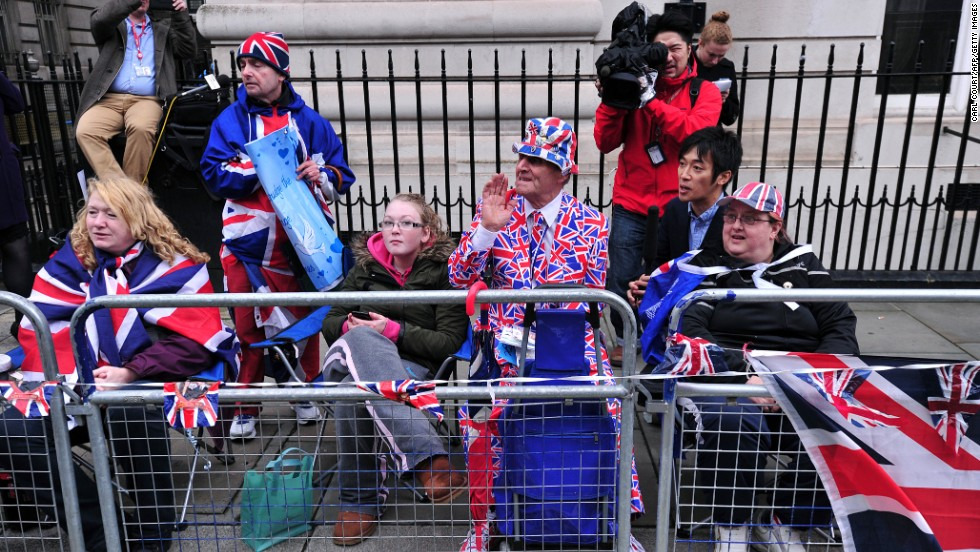 Spectators sport the colors as they wait for the royal family to arrive.