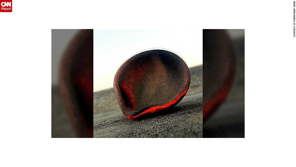 "Paramveer Singh took this photo of a diya at his home last year. He says the diya had been burning all night on the roof of his family home in the <a href=""http://instagram.com/ShuffleSingh"" target=""_blank"">Punjab region of India</a>."