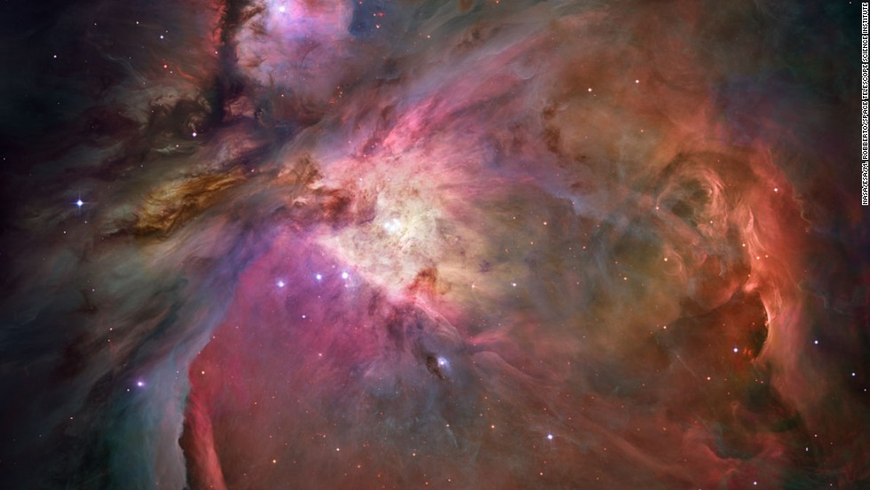 More than 3,000 stars of various sizes appear in this image of the Orion Nebula. Some of them have never been seen in visible light. Ultraviolet light from the four central stars is carving a cavity in the nebula and disrupting the growth of hundreds of smaller stars.