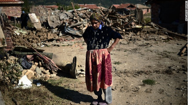 A Roma woman stands in front of her demolished house in a Roma suburb in the town of Maglizh on September 25, 2012. Thirty-two illegally built Roma houses were destroyed in the periphery of the central Bulgarian town of Maglizh on September 25.