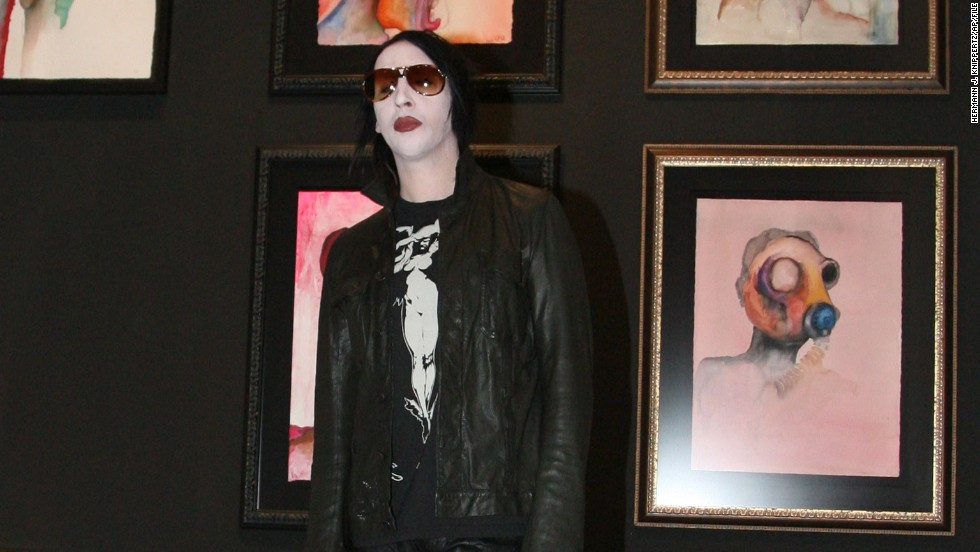 Marilyn Manson, another painter, opens an exhibition of his work at a Cologne, Germany, gallery in 2007.