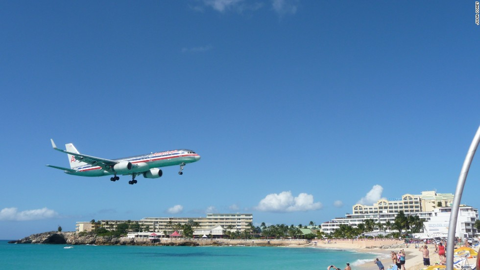 The beach-skimming landing approach at this Caribbean airport has people gnawing their fingers in the plane and on the ground.